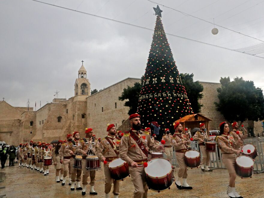 A Palestinian scouts band parades in front of the Church of the Nativity during Christmas celebrations in Bethlehem in the occupied West Bank, on Dec. 24, 2020. Annual festivities around the Church of the Nativity were scaled back but Bethlehem residents were intent on maintaining traditions.