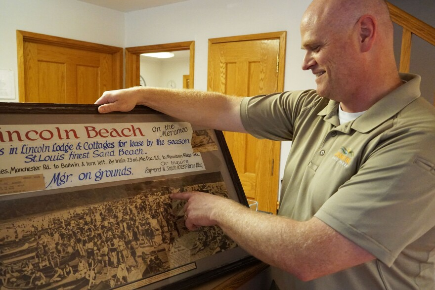 Castlewood State Park Superintendent Jeff Bonney describes a photo of Lincoln Beach on July 15, 2019. The walls of the park office are lined with photos of the Castlewood resort area before it became a park.