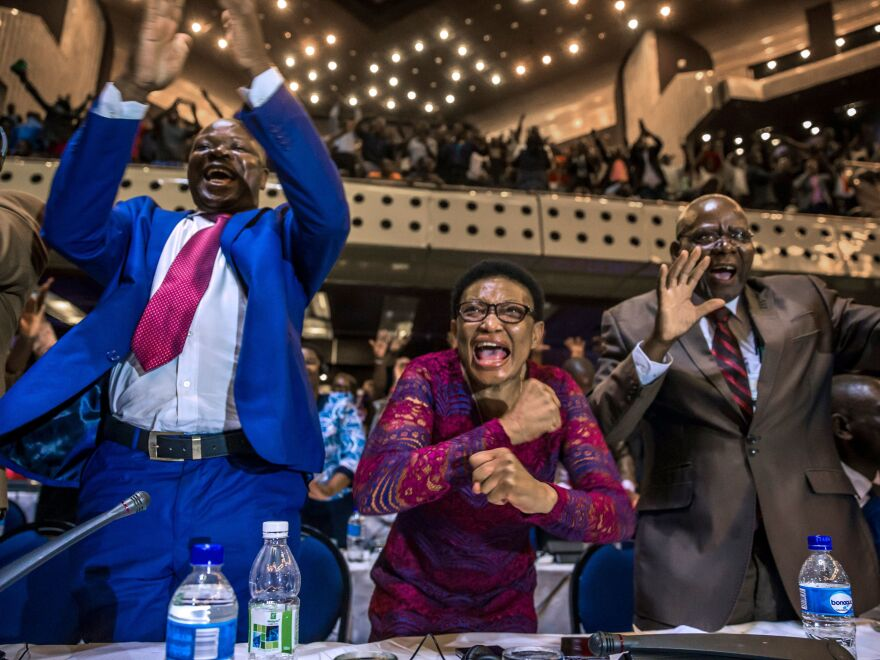 Members of Zimbabwe's parliament celebrate after receiving news of Mugabe's resignation on Tuesday.