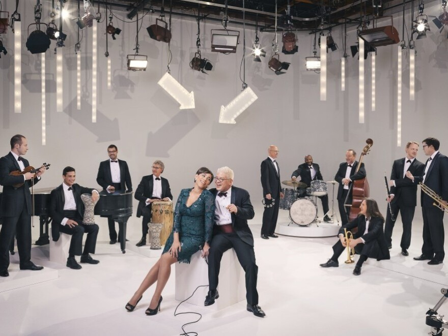 Pink Martini band leader Thomas Lauderdale anchors the concert from his piano, with singers China Forbes, Storm Large, NPR's very own Ari Shapiro and more special guests.