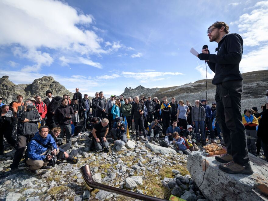 "People take part in a ceremony to mark the ""death"" of the Pizol glacier on Sunday in eastern Switzerland."