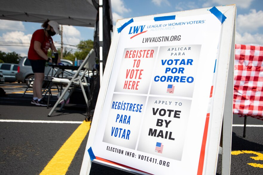A sign in Spanish and English lets people know they can get information on registering to vote.