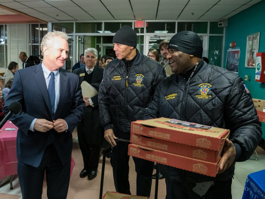Sen. Chris Van Hollen and local firefighters showed support for furloughed workers at a community potluck.