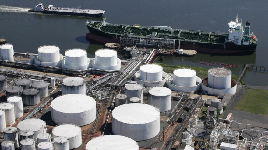<p>An oil tanker is docked at the Kinder Morgan terminal in Carteret, N.J. Kinder Morgan Energy Partners LP operates pipelines and terminals for oil and natural gas. The company's purchase of El Paso Corporation expands its pipeline to 80,000 miles.</p>