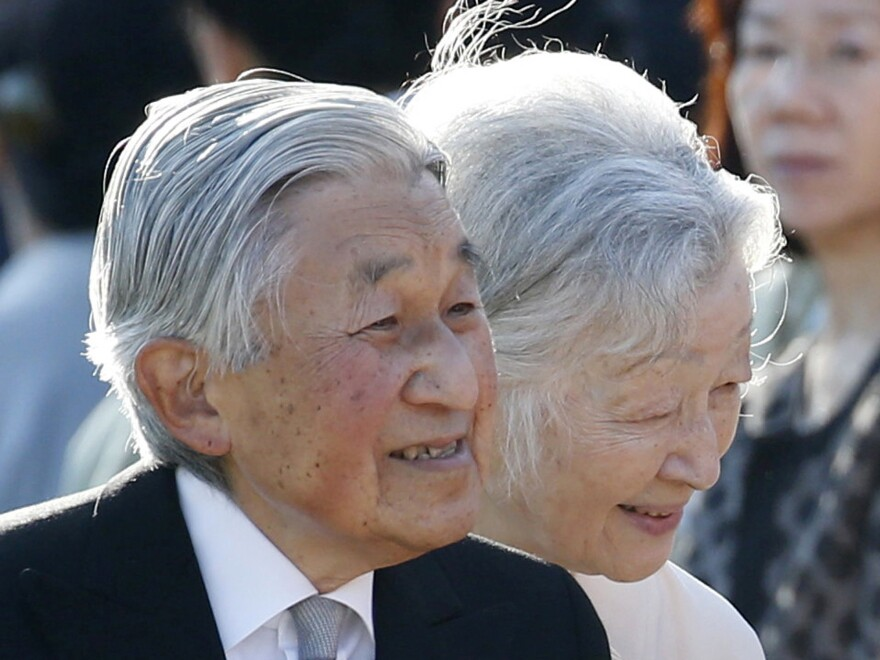 Japan's Emperor Akihito, left, and Empress Michiko, greet guests during the annual autumn garden party at the Akasaka Palace imperial garden in Tokyo earlier this month.