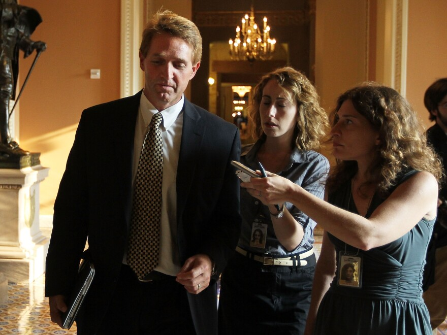 Rep. Jeff Flake, R-Ariz, answers questions from reporters after a vote on the Budget Control Act July 29, 2011 at the Capitol Building. An Arizona lawyer recently formed a small superPAC to oppose Flake in his primary election.