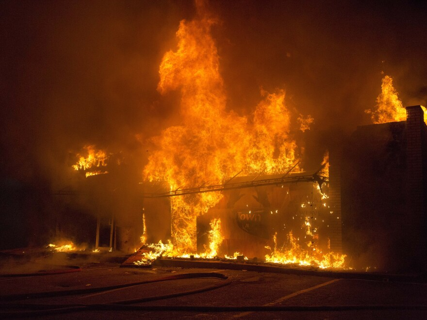 A business burns during rioting Monday night in Ferguson, Mo.