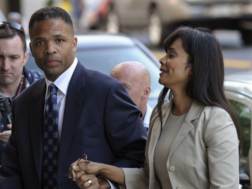 In this Aug. 14, 2013 file photo, former Illinois Rep. Jesse Jackson Jr. and his wife, Sandra, arrive at federal court in Washington to learn their fates when a federal judge sentences the one-time power couple for misusing $750,000 in campaign money.