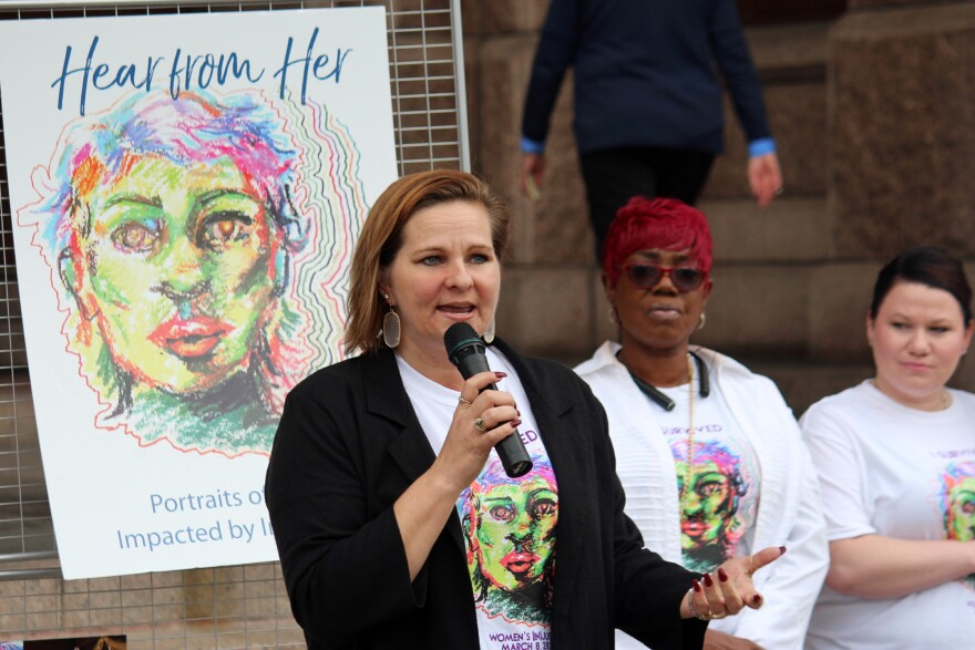 Lauren Johnson speaks at a rally for legislation to address the issues affecting women in the criminal justice system.