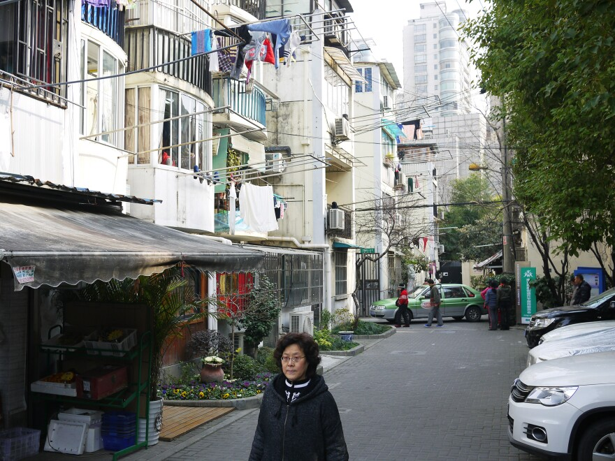 Rising Peace Lane cuts through the heart of downtown Shanghai. Typically this street is filled with activity, but during Lunar New Year, residents return to their hometowns to visit family.