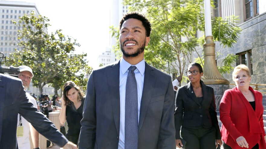 NBA star Derrick Rose leaves federal court in Los Angeles. Jurors cleared Rose and two friends in a lawsuit that accused them of gang raping his ex-girlfriend when she was incapacitated.