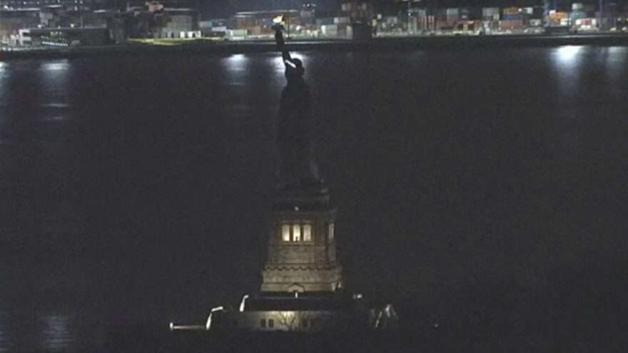 The Statue of Liberty was in the dark for more than an hour Tuesday night, as this still image taken from video shows. A National Park Service official says the unplanned outage was likely because of work on a backup generator.