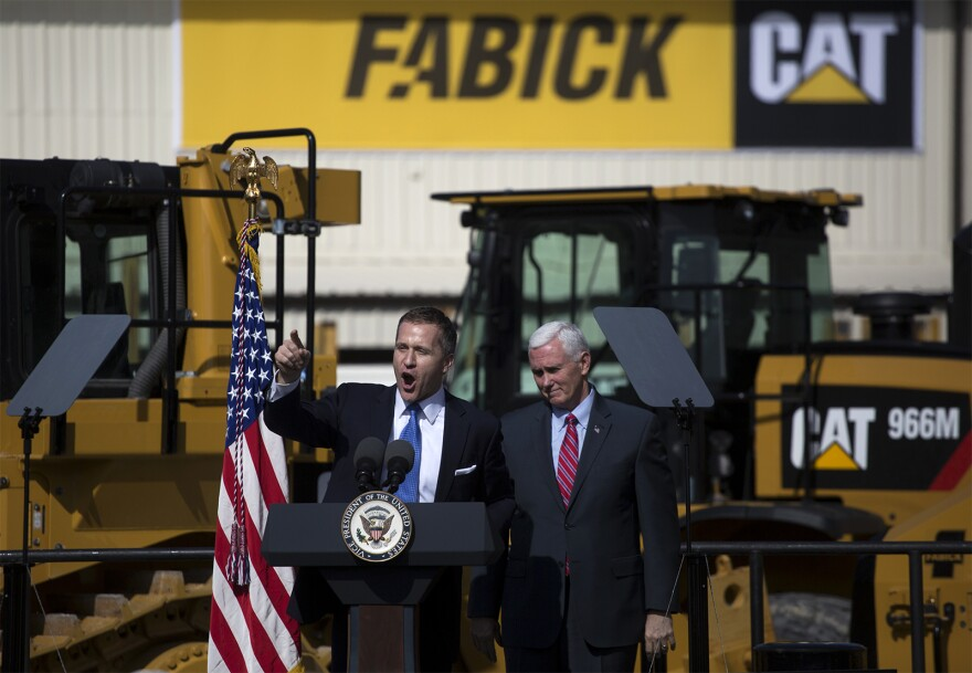 Missouri Gov. Eric Greitens introduces Vice President Mike Pence at Fabick Cat.