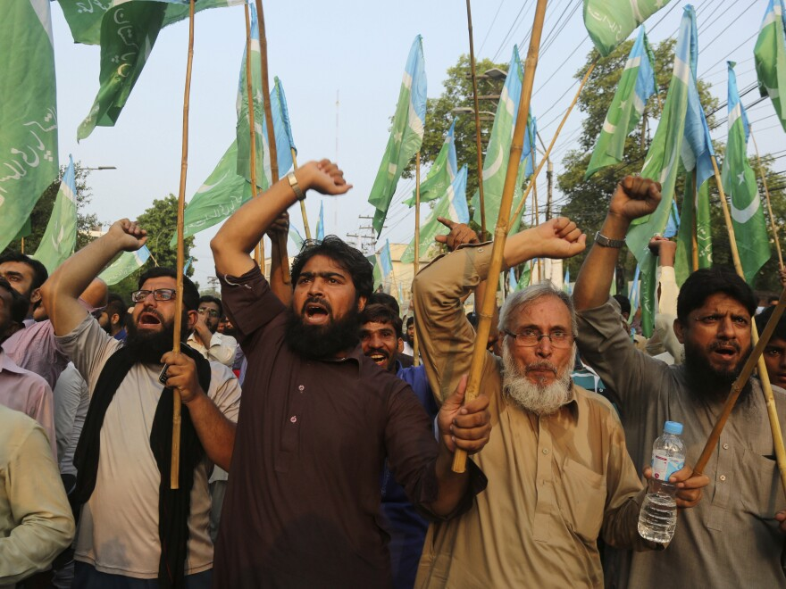 Supporters of the Pakistani religious party Jamaat-e-Islami demonstrate in Lahore, Pakistan, on Tuesday to protest India's policy on Kashmir.