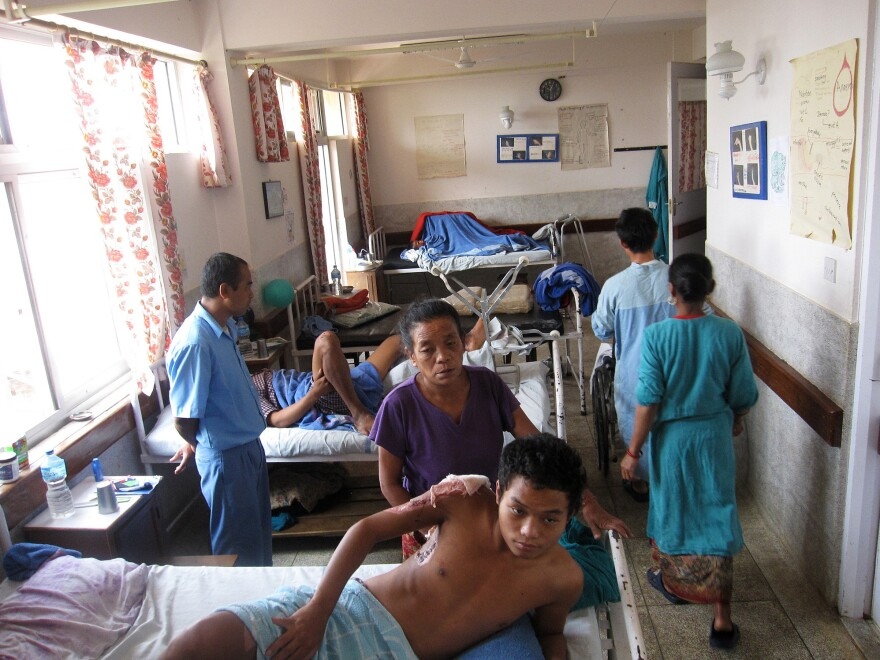 Patients recovering from burns share a ward at a Nepalese hospital.