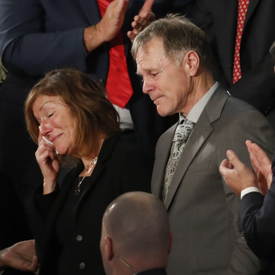 The parents of Otto Warmbier react to a standing ovation during President Trump's Jan. 30, 2018, State of the Union address on Capitol Hill in Washington.