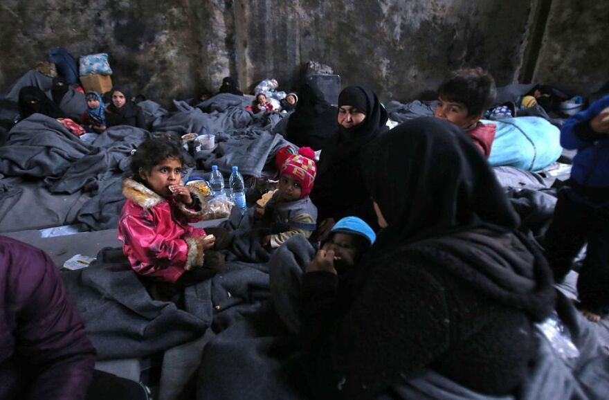 Syrians who fled rebel-held areas of Aleppo take shelter Wednesday in the nearby town of Jibrin.