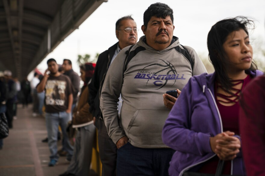 Marvin Sr. waits in line on the international bridge for his final immigration hearing. A judge denied his application for asylum that afternoon. Marvin remains in the Matamoros refugee camp with no good options left.