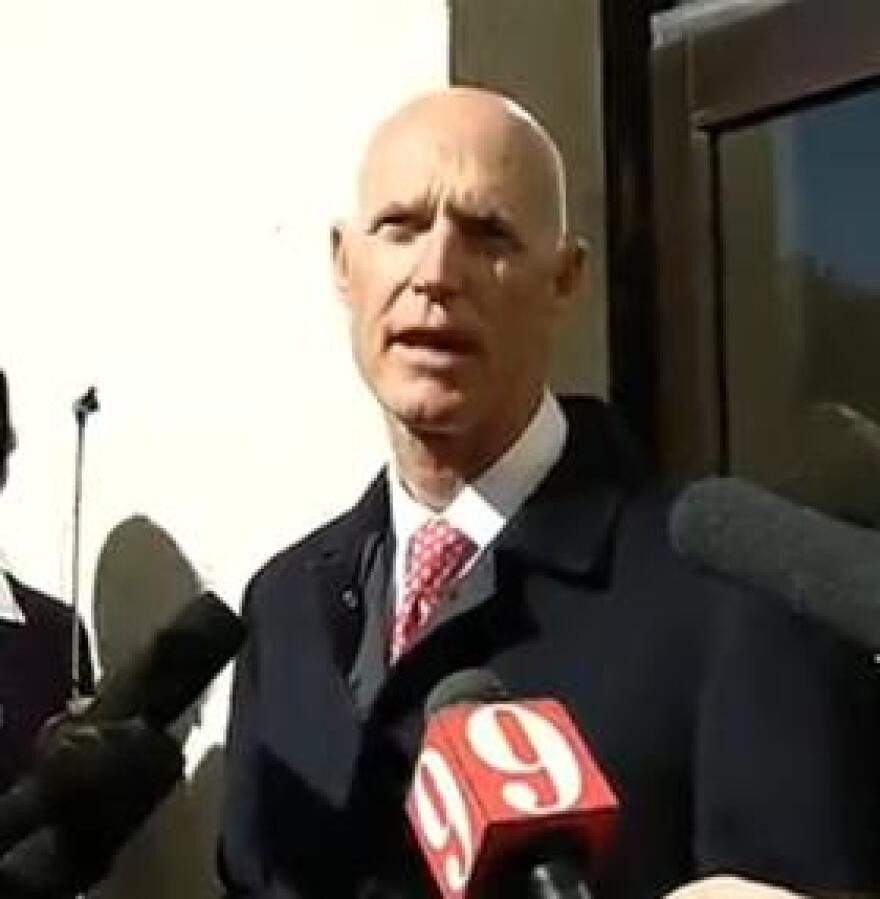 Gov. Rick Scott speaking to reporters, following his State of the State address Tuesday.