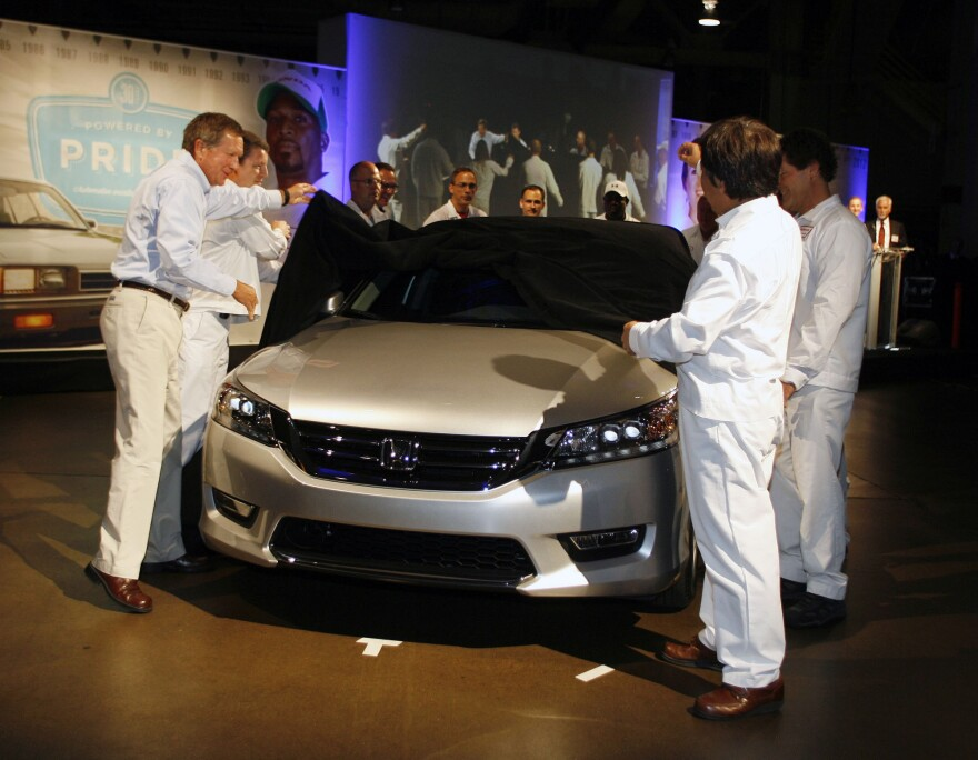 Ohio Gov. John Kasich (left) and Hide Iwata, president and CEO of Honda of America Manufacturing, unveil a new 2013 Honda Accord at the Marysville Auto Plant on Aug. 20 in Marysville, Ohio.
