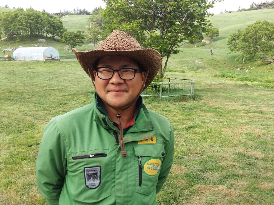 Jeon Chung-won, 32, on his family's sheep farm in PyeongChang, South Korea. Jeon charges tourists a small fee to go hiking on his farm, and is expecting thousands of visitors this winter for the Olympic Games.