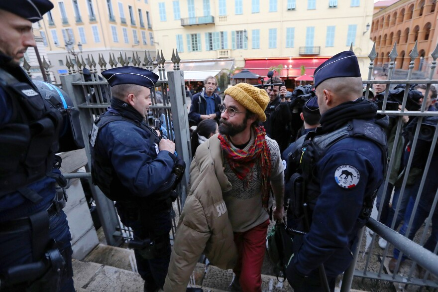 French farmer Cedric Herrou arrives at a court in Nice on Friday for his trial for illegally assisting migrants. Herrou, who helped African migrants to enter the country from Italy, was given a suspended fine of 3,000 euros, about $3,000.