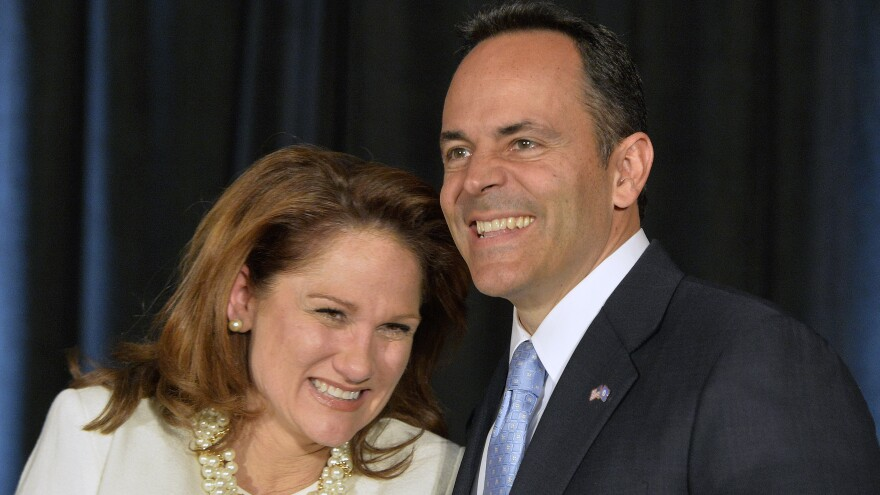 Kentucky Gov.-elect Matt Bevin and his wife, Glenna, react to the cheers of supporters during his introduction at the Republican Party victory celebration Tuesday.