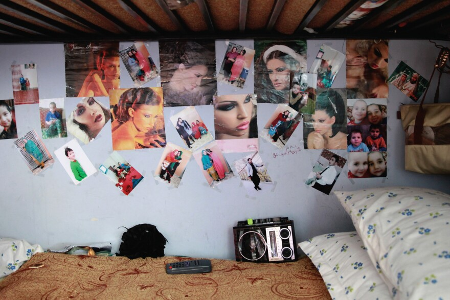 The pages of fashion magazines adorn the walls of a room in the women's prison.