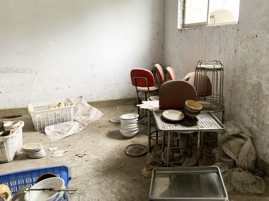 Discarded kitchenware lies on the floor of Magou Mosque's Islamic School in Zhengzhou, Henan province. It was forced to close suddenly last year.