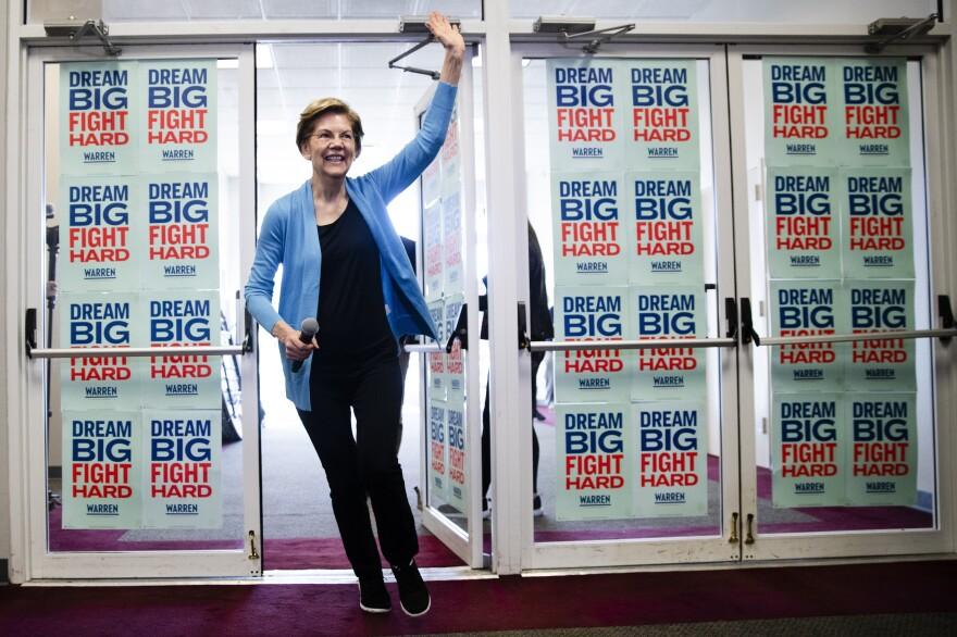 Sen. Elizabeth Warren waves to supporters and volunteers during her presidential run in February.