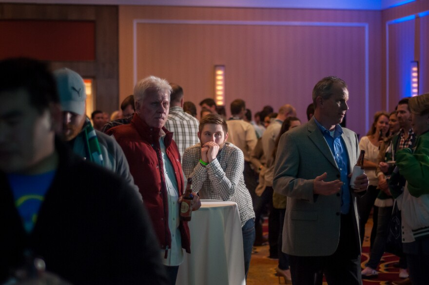 Hunter Maret of University City watches Proposition 2 election results at Union Station at a pro-soccer stadium gathering Tuesday night.