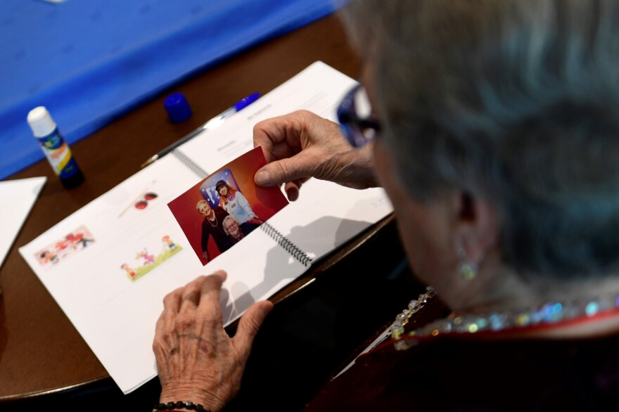 A patient affected by Alzheimer's disease attends a special therapeutic session. (Pierre-Philippe Marcou/Getty Images)