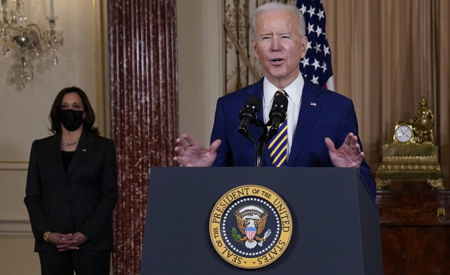 "President Biden speaks at the State Department on Feb. 4 as Vice President Kamala Harris looks on. ""We've elevated the status of cyber issues within our government,"" said Biden, whose administration is investigating a major cyber breach blamed on Russia."