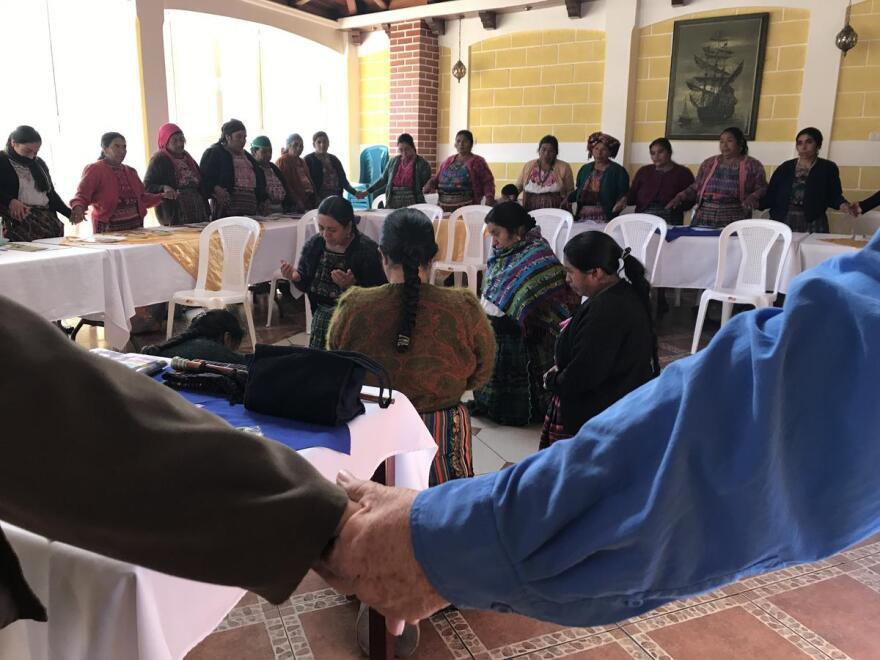 About 40 medicine women from across Totonicapán start their sex ed workshop by joining hands and praying.