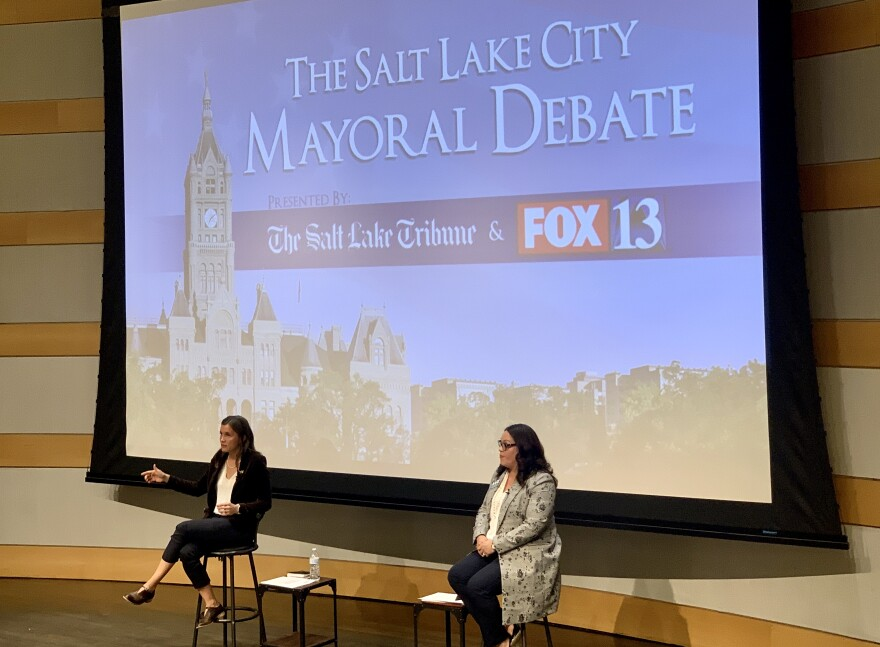 Mayoral canididates on a debate stage.