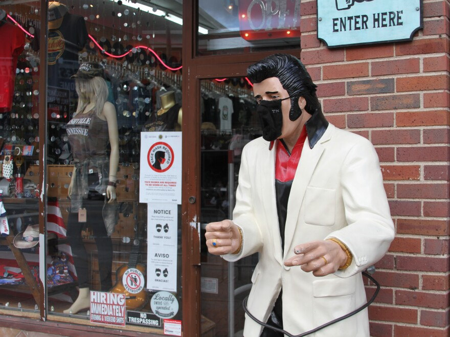 An Elvis Presley statue on Nashville's Lower Broadway wears a state-issued mask.