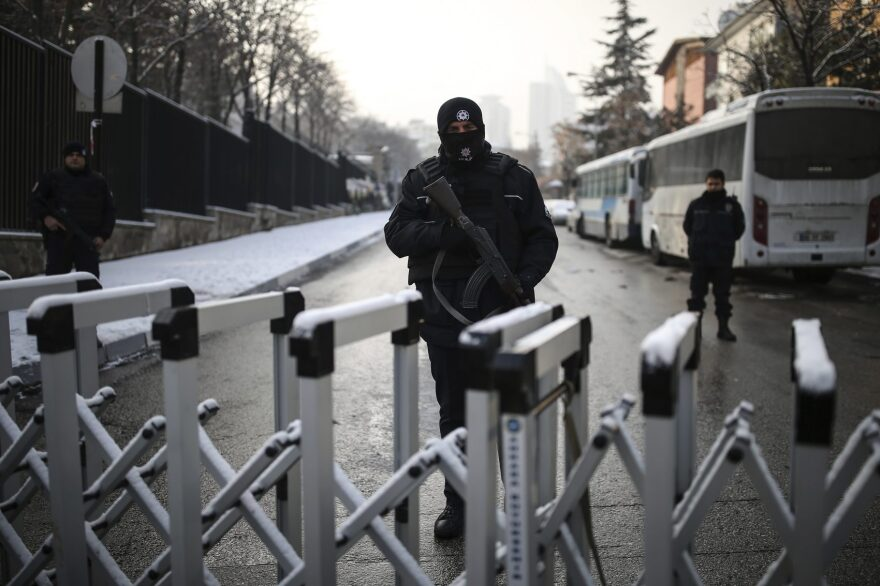 A Turkish police officer secures the road leading to the Russian embassy in Ankara, Turkey, Wednesday, Dec, 21, 2016. Russian Ambassador to Turkey, Andrei Karlov, was assassinated Monday by a police officer during the opening of a photo exhibition. (Emrah Gurel/AP)