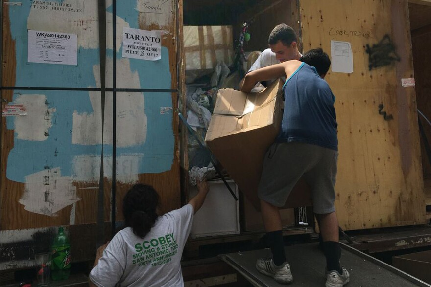 Movers unpack a van at Sarah Taranto's house in May 2017. Many of the Tarantos' possessions arrived damaged, while other had been stolen during the moving process.