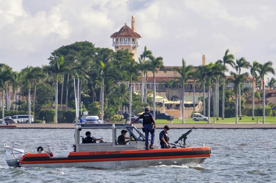 The U.S. Coast Guard patrol boat passes President Donald Trump's Mar-a-Lago estate in Palm Beach, Fla., Thursday, Nov. 22, 2018. (J. David Ake/AP)