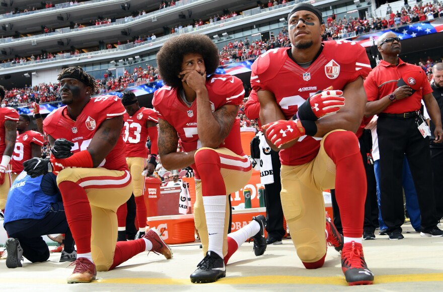 Then-San Francisco 49ers quarterback Colin Kaepernick kneels during the national anthem in a game against the Dallas Cowboys last year.