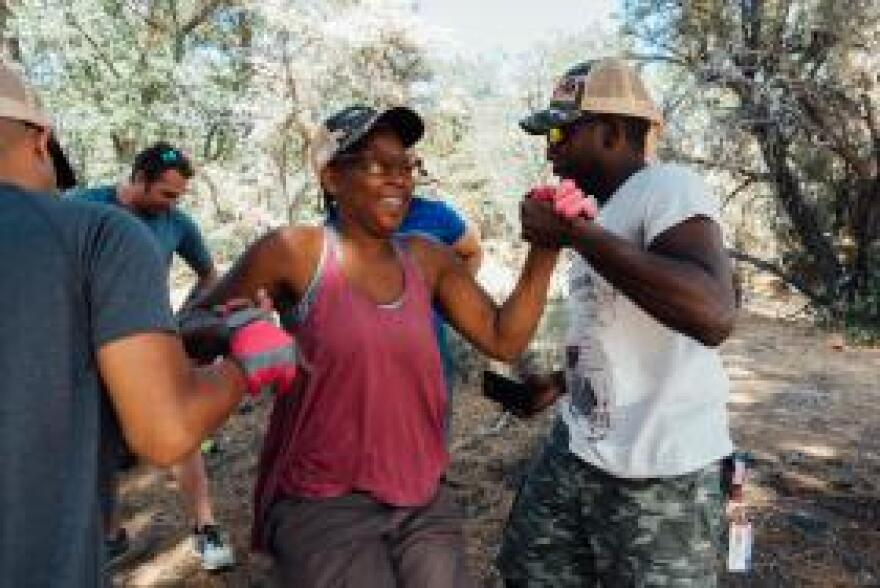 Navy veteran Samantha Scully completes a team building exercise during a trip with the non-profit Higher Ground in Big Bear, Cal.