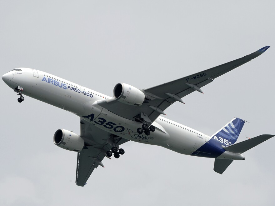 The Airbus A350-900 flies in the aerial display on the first day of the Singapore Air Show in February. Dubai-based Emirates Airlines announced Wednesday it was canceling an order for 70 of the planes.