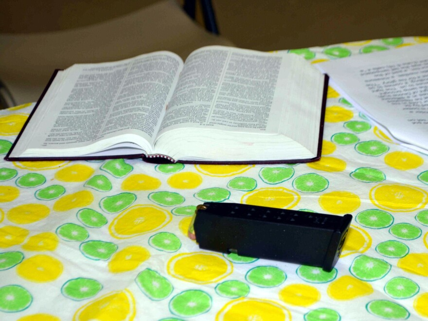 A loaded gun magazine rests on a table next to an open Bible in June 2015 at Emanuel African Methodist Episcopal Church, after a shooting at a Bible study that left nine attendees dead.