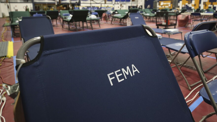 A portable FEMA cot at a temporary medical facility in a gym at Southern New Hampshire University.