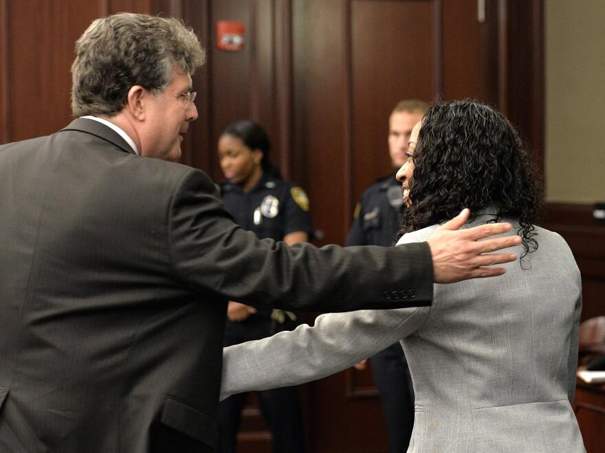 Lawyer Bruce Zimet comforts Marissa Alexander during a hearing Monday in Jacksonville, Fla.