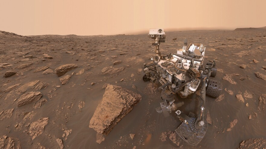 A dust storm has reduced sunlight and visibility on Mars. But NASA's Curiosity rover, seen in a self-portrait taken last week in the Gale Crater, runs on nuclear energy and is powering through.