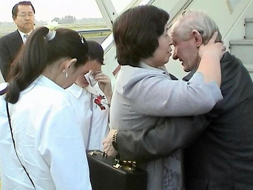 Hitomi Soga embraces her husband, U.S. Army defector Charles Robert Jenkins, as the two are reunited at the airport in Jakarta, Indonesia, in 2004, after Jenkins' release.