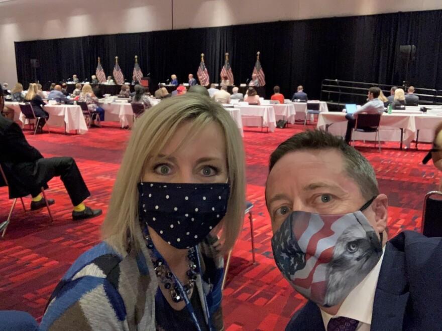 Photo of Amy Winder Newton and Derek Brown wearing masks.