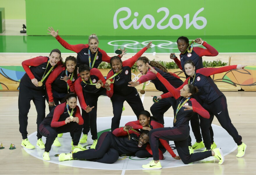 The U.S. women's basketball team poses Saturday after winning its sixth straight gold medal and its 49th straight game in the Olympics. The team's success reflects the growing dominance of U.S. women in recent Olympiads. The U.S. women have won more medals than the American men in the past two Summer Games.
