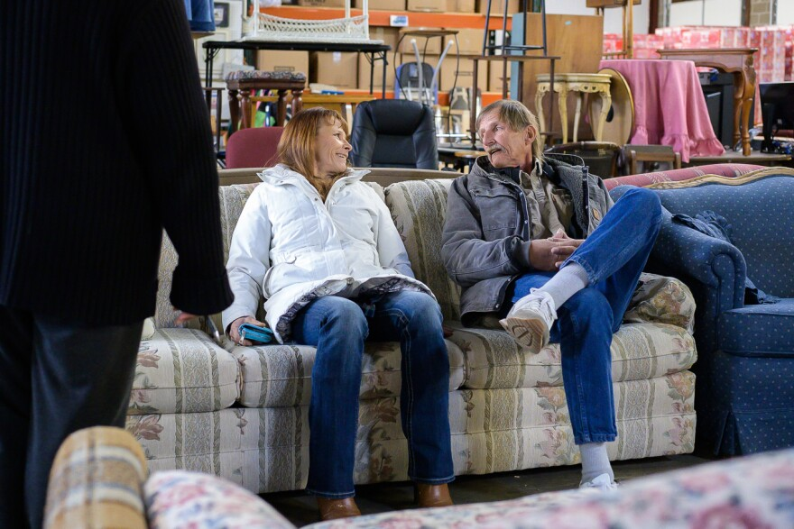 Mary and George Hayes test the comfort level of a couch at the Home Sweet Home furniture bank on Feb. 27, 2019.